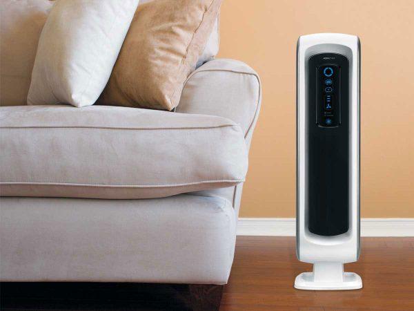 Fellowes® AeraMax DX5 Air Purifier next to sofa
