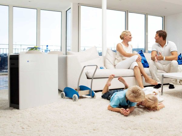 Family relaxing at home with Blueair air purifier